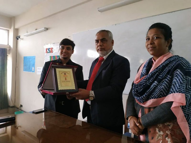 Receiving crest from Gono University